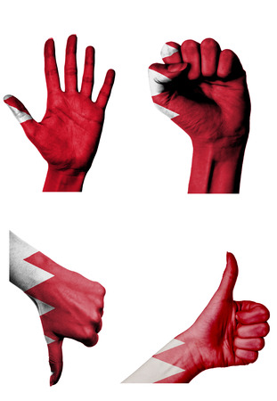 closed fist: hands with multiple gestures (open palm, closed fist, thumbs up and down) with Bahrain flag painted isolated on white