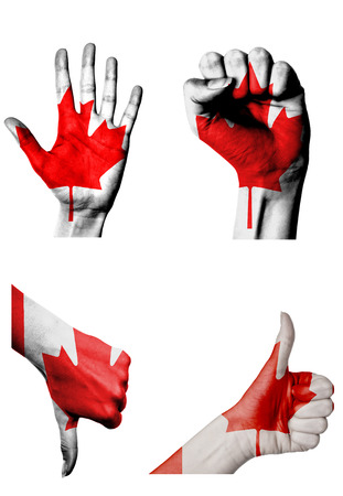 closed fist: hands with multiple gestures (open palm, closed fist, thumbs up and down) with Canada flag painted isolated on white