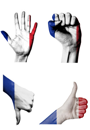 closed fist: hands with multiple gestures (open palm, closed fist, thumbs up and down) with France flag painted isolated on white Stock Photo
