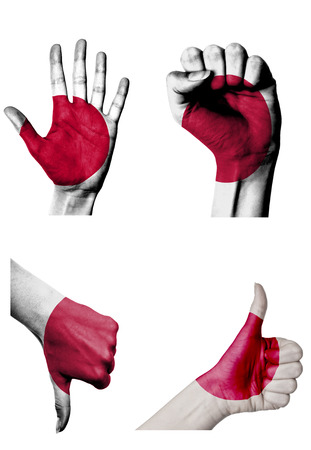 hands with multiple gestures (open palm, closed fist, thumbs up and down) with Japan flag painted isolated on white photo