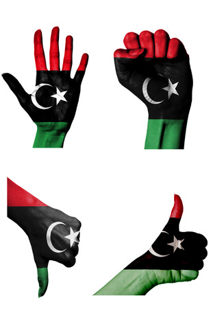 closed fist: hands with multiple gestures (open palm, closed fist, thumbs up and down) with Libya flag painted isolated on white Stock Photo