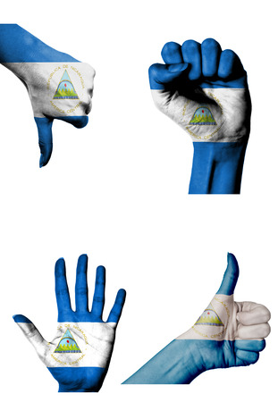 closed fist: hands with multiple gestures (open palm, closed fist, thumbs up and down) with Nicaragua flag painted isolated on white Stock Photo