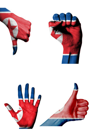 closed fist: hands with multiple gestures (open palm, closed fist, thumbs up and down) with North Korea flag painted isolated on white Stock Photo