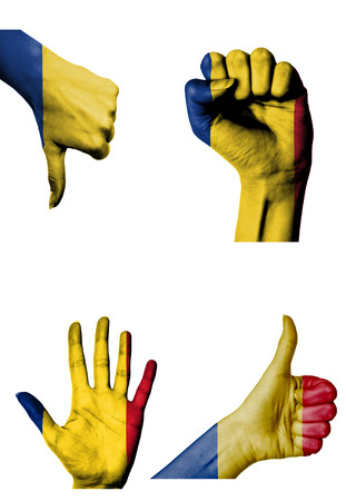 hands with multiple gestures (open palm, closed fist, thumbs up and down) with Romania flag painted isolated on white photo