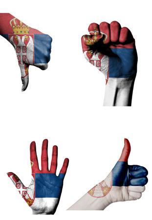 closed fist: hands with multiple gestures (open palm, closed fist, thumbs up and down) with Serbia flag painted isolated on white Stock Photo
