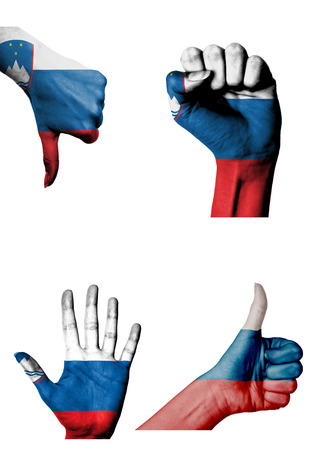 closed fist: hands with multiple gestures (open palm, closed fist, thumbs up and down) with Slovenia flag painted isolated on white Stock Photo