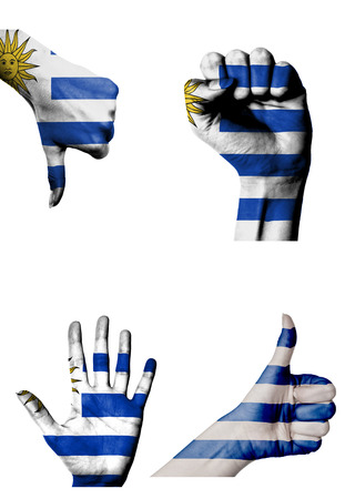 closed fist: hands with multiple gestures  open palm, closed fist, thumbs up and down  with Uruguay flag painted isolated on white