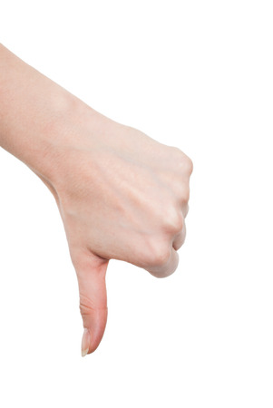 negation: Hand thumb down isolated on white background  No sign by woman  Symbol of rejection and negation