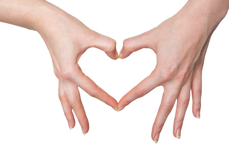 Women making a heart sign with hands isolated on white background photo