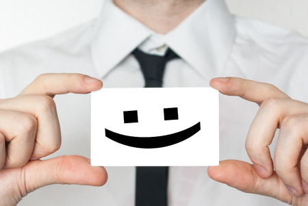 Smile happy face  Businessman in white shirt with a black tie showing or holding business card