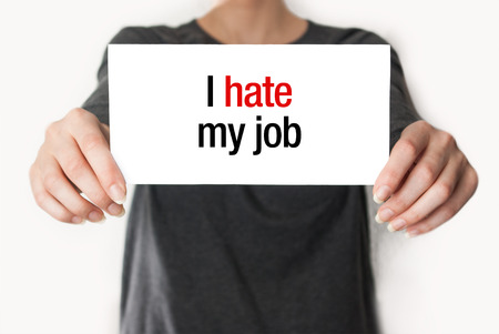 Girl or employee holding showing card with text I hate my job photo