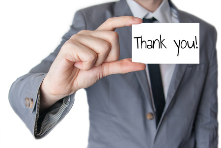 Businessman holding or showing card with thank you text photo