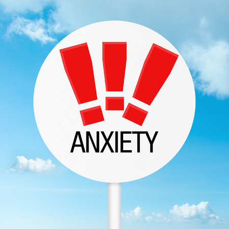 Anxiety warning road sign with sky photo