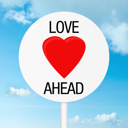Love ahead road sign with sky background photo