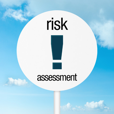 Risk assessment warning road sign with sky photo