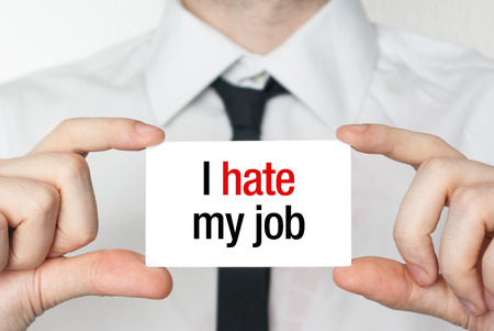 place of work: Businessman or employee holding showing card with text I hate my job