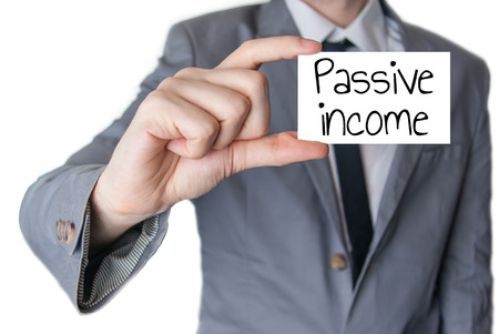 Businessman holding or showing card with text passive income