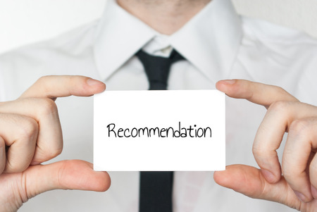 recommendations: Businessman holding or showing card with text recommendation Stock Photo