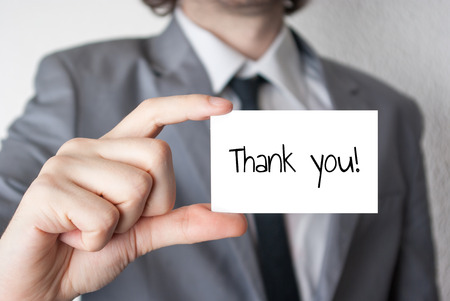 appreciate: Businessman holding or showing card with thank you text