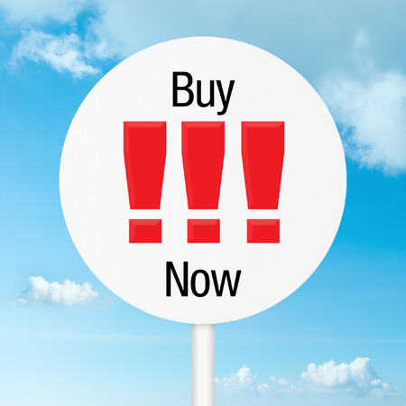 Buy now road sign with sky as a background photo