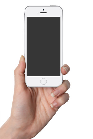 Woman hand holding white smart phone with isolated screen in hand, isolated photo
