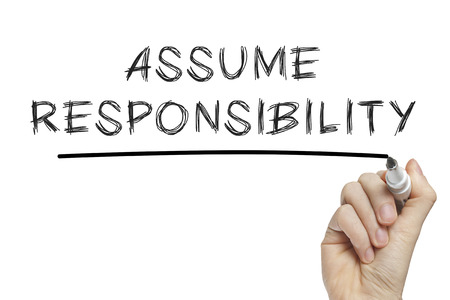 responsibilities: Hand writing assume responsibility on a white board Stock Photo