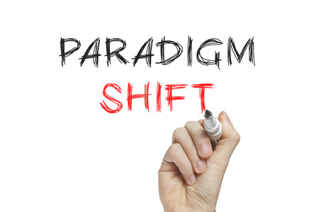 Hand writing paradigm shift on a white board