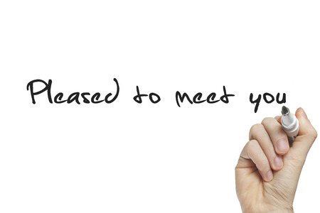 Hand writing pleased to meet you on a white board
