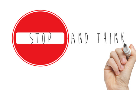 road warning sign: Stop and think handwritten with a marker on a whiteboard with a stop sign
