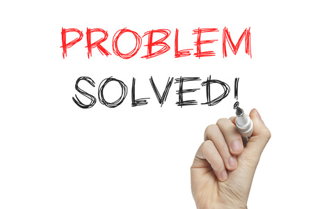 resolved: Hand writing problem solved on a white board Stock Photo