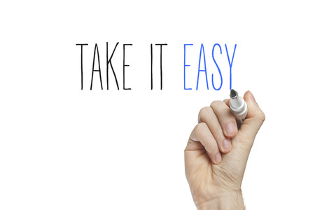 take it easy: Hand writing take it easy on a white board Stock Photo