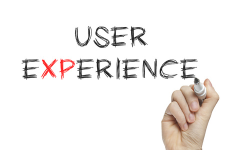 Hand writing user experience on a white board photo