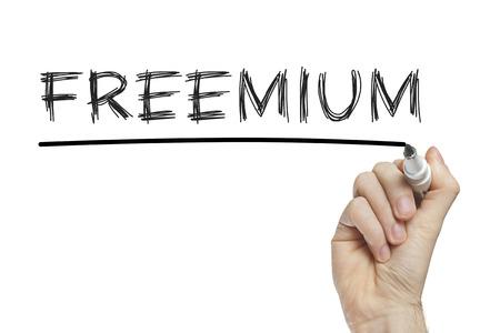 monetization: Hand writing freemium on a white board Stock Photo