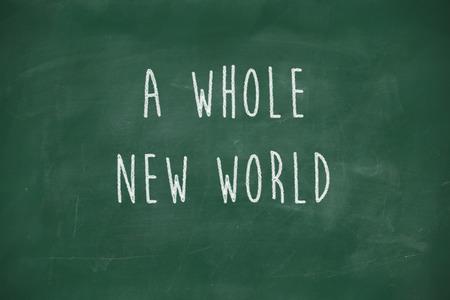 A whole new world handwritten on school blackboard photo