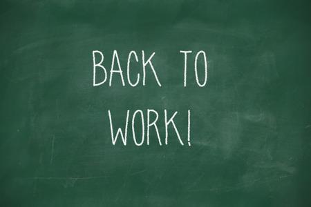 Back to work handwritten on school blackboard photo