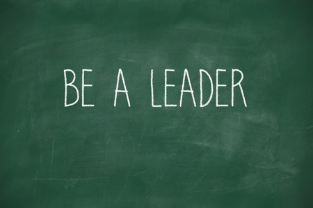 initiator: Be a leader handwritten on school blackboard