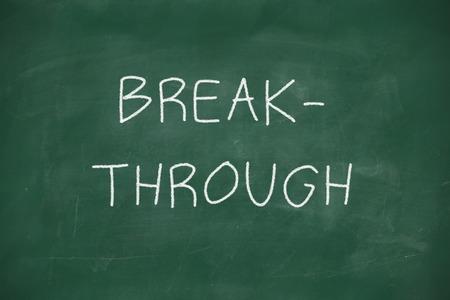 Breakthroughhandwritten on school blackboard photo