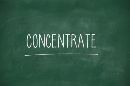 Concentrate handwritten on school blackboard photo