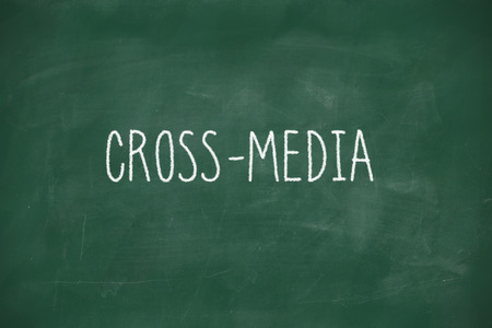 Cross media handwritten on school blackboard photo