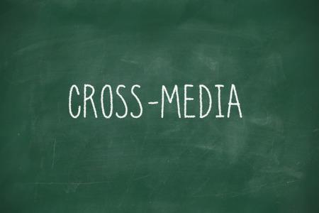Cross media handwritten on school blackboard photo