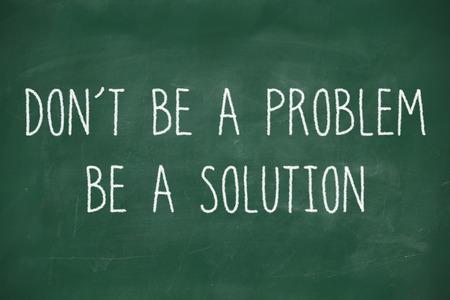 Dont be a problem handwritten on school blackboard photo