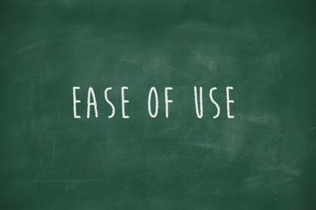at ease: Ease of use handwritten on school blackboard Stock Photo