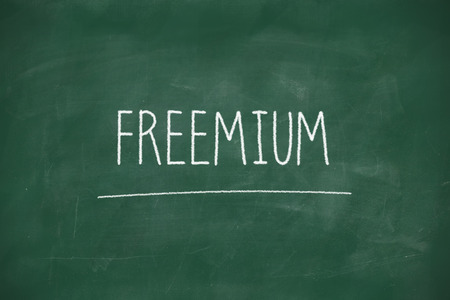 Freemium handwritten on school blackboard photo