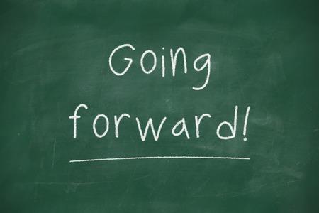 Going forward handwritten on school blackboard photo