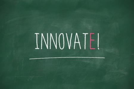 Innovate handwritten on school blackboard photo