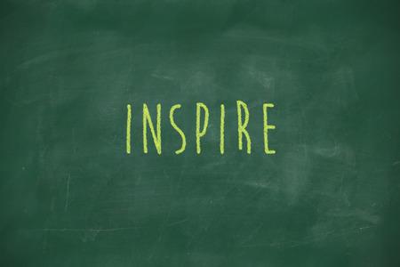 Inspire handwritten on school blackboard photo