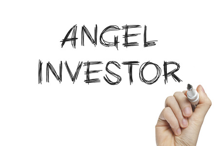 capitalist: Hand writing angel investor on a white board