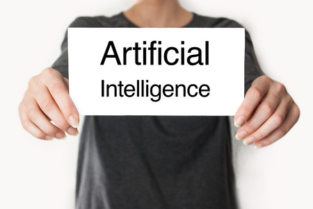 Artificial intelligence. Female in black shirt showing or holding a card photo