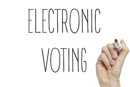 electronic voting: Hand writing electronic voting on a white board Stock Photo