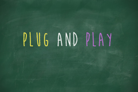 Plug and play handwritten on school blackboard photo